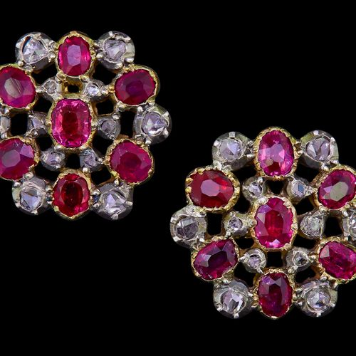 PAIR OF ANTIQUE RUBY AND DIAMOND EARRINGS, of openwork design, set with a centra…