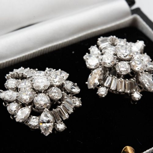IMPORTANT PAIR OF DIAMOND CLIP EARRINGS, Each designed as a tiered cluster of ma…