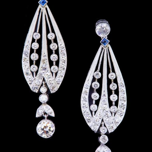 PAIR OF SAPPHIRE AND DIAMOND DROP EARRINGS, set with a diamond top, suspending a…