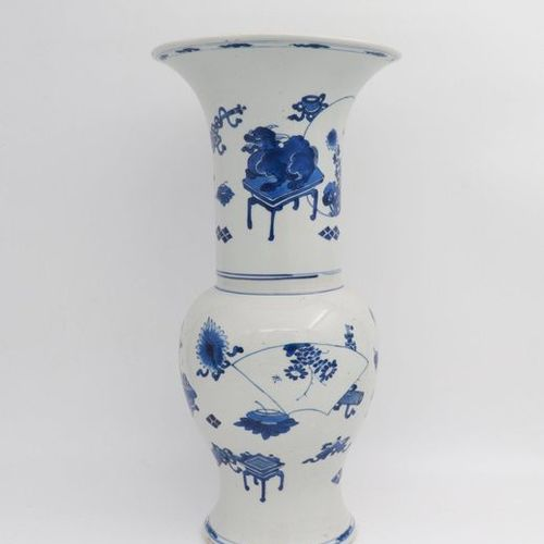 CHINA, XVIII CENTURY A blue and white beaker vase, XVII century modeled after ar…
