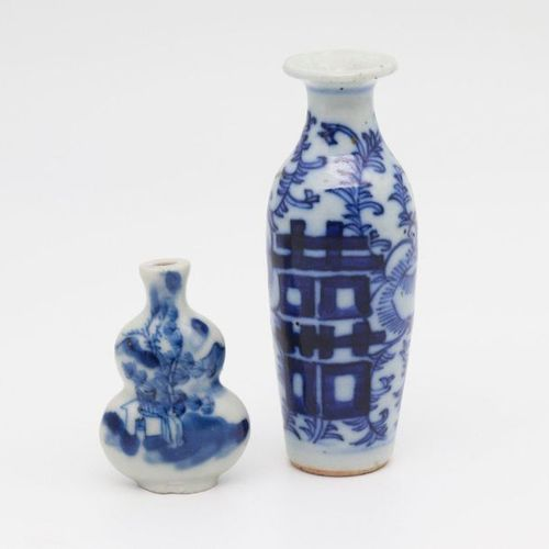 CHINA, XIX CENTURY A pair of perfume bottles, XIX century Porcelain, decorated w…