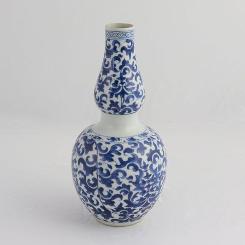 CHINA, XIX CENTURY A blue and white double gourd vase, XIX century painted aroun…