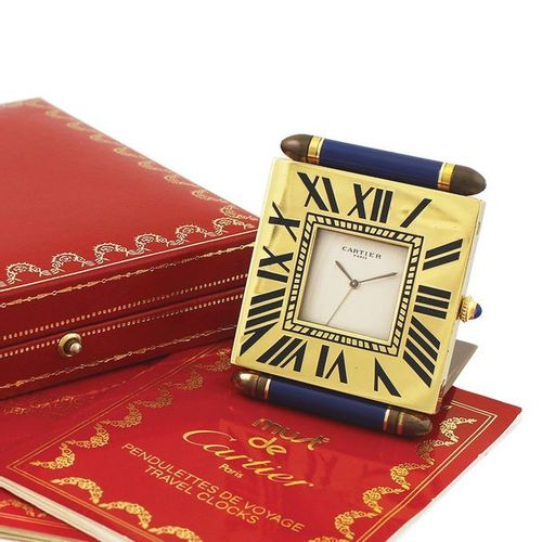"CARTIER ""Must"" Desk Clock Fine and small, quartz, gilt brass desk clock with ala…"