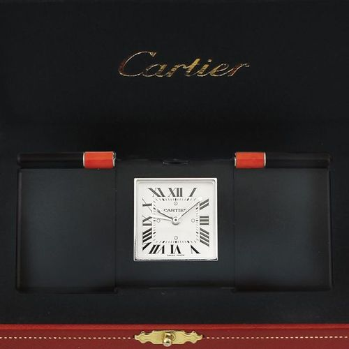 "CARTIER ""Ermeto"" Fine, quartz desk clock with alarm and two coral inserts. Accom…"