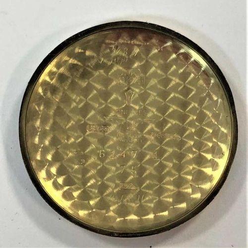 C1953, le cadran signé de couleur crème, 28mm de diamètre, avec chiffres arabes …