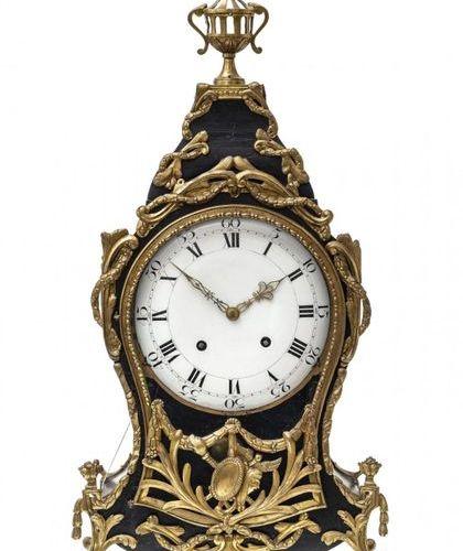 Neuchâtel clockSwitzerland, 19th century. Curved, blackened wooden case with bro…