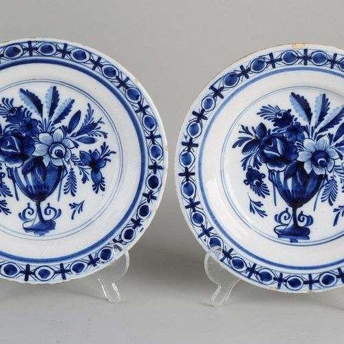 Two 18th century Delft Fayence plates with flower vase decoration.Size: Ø 24 cm…
