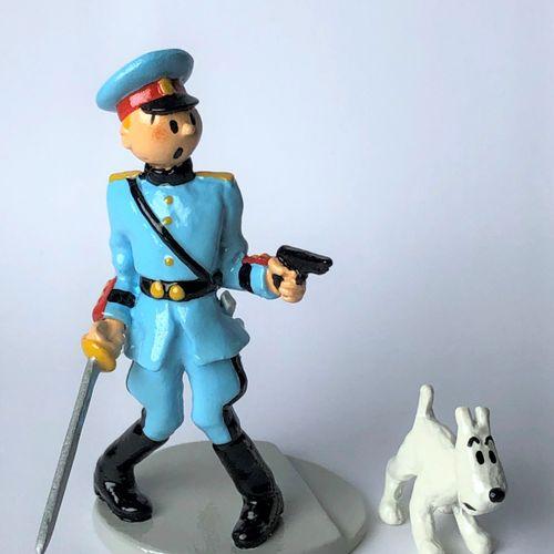 Hergé/Tintin. Sculpture illustrating Tintin in commander's uniform with Snowy, i…