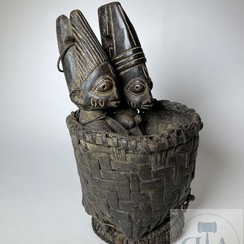 Pair of Ibejis statuette, Type Ila Orangun, (in wicker basket) Yoruba, Nigeria P…