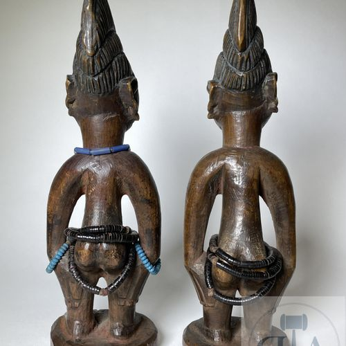 Pair of Ibidji statuette, type Ila (in cloak), Yoruba, Nigeria Published on page…