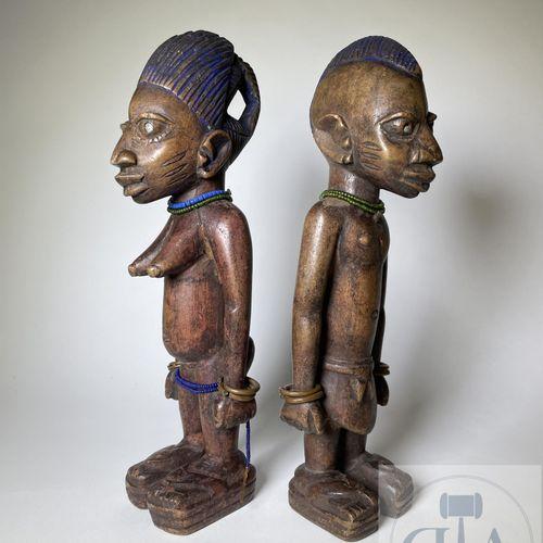 Pair of Ibejis statuette, Ilorin type, Yoruba, Nigeria. H 33 cm. Large size, thi…