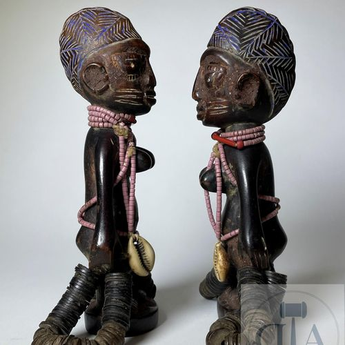 Pair of Ibejis statuette, Ilorin type, Yoruba, Nigeria. H 19 cm This pair of bea…