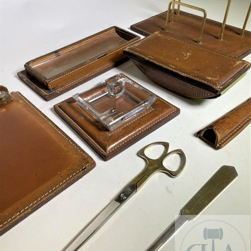 A 7 piece desk set: scissors, letter opener, ashtray, notepad, letter holder, bl…