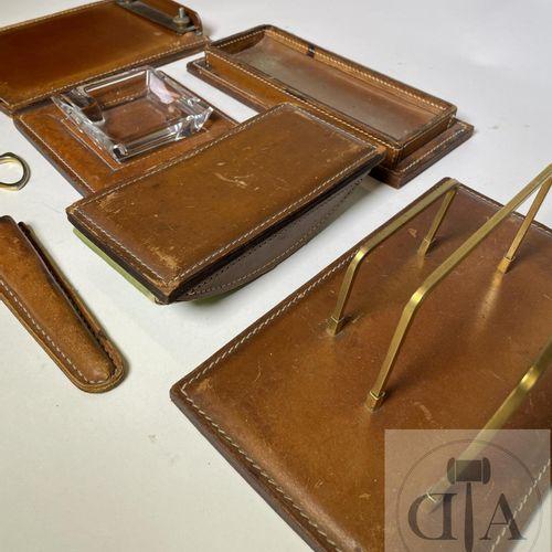 A 7 piece desk set: scissors, letter opener, ashtray, notepad, letter holder, bl…