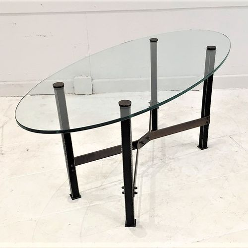 """Coffee table """"Canasta"""" by Mathieu Matégot around 1960. Leather covered brass and…"""