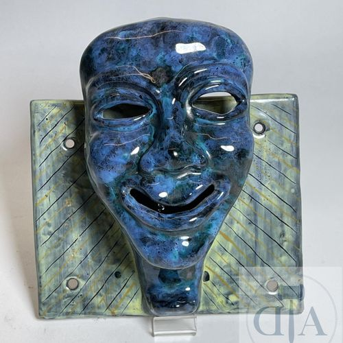 "Coat hook representing a smiling mask. Signed ""Academia italia"". Ceramic around …"