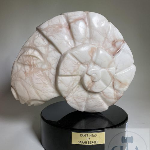 Sculpture representing a ram's head by Sarah Berger. Pink marble from Colorado o…