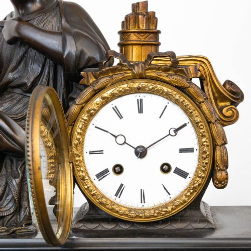 A 3 piece mantle garniture consisting of a clock with bronze figurine and 2 cand…