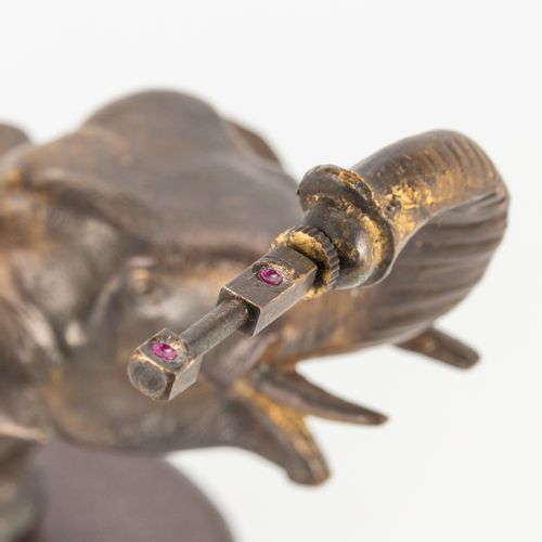 A statue of an Elephant with a mysterious clock movement, marked Junghans and st…