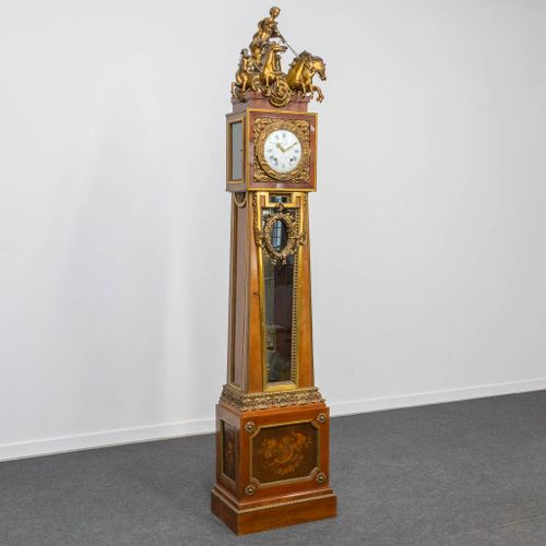 An impressive and important standing clock in Louis XVI style, with a bronze bat…