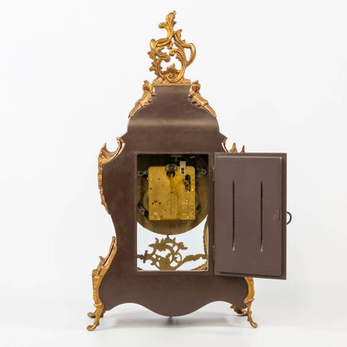 A table clock mounted with bronze and finished with marquetry. The second half o…