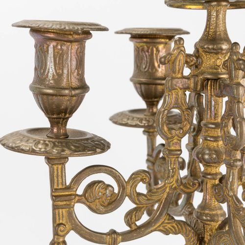 A bronze 3 piece garniture with clock and candelabra. The second half of the 20t…