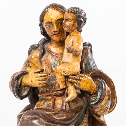 A wood sculptured Madonna with child trampling the serpent on the half moon, Spa…