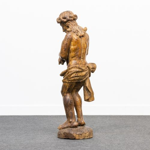 A wood sculptured statue of Jesus Christ, 16th/17th century. (21 x 22 x 80 cm)