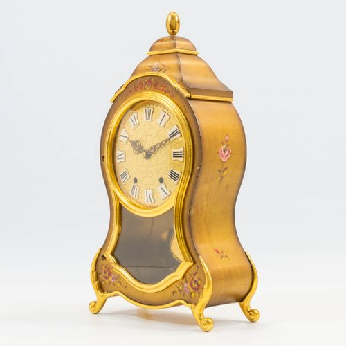 A Table clock with hand painted flower decor, marked Eluxa. The second half of t…