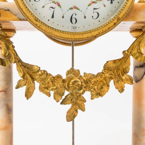 A 3 piece mantle clock: a column clock with 2 side pieces. Made of marble with b…