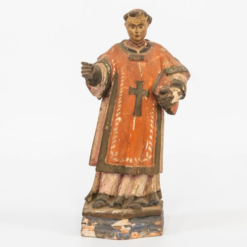 A sculptured wood statue of a holy figurine, with book. 18th century. (7,5 x 11 …