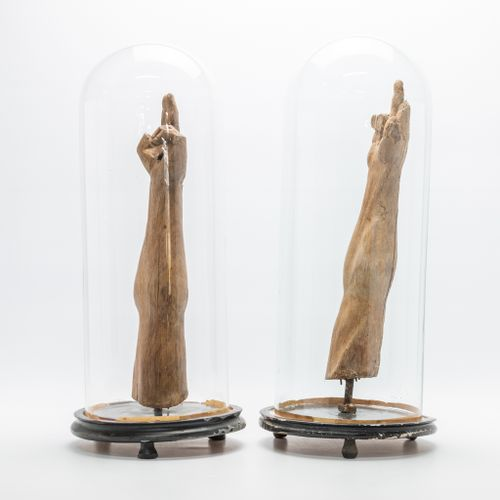 A pair of wood sculptures, 'The arms of Christ', mounted on a stand and displaye…
