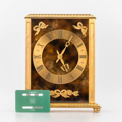 A table clock made of brass and marked Hour Lavigne, made in France. The second …
