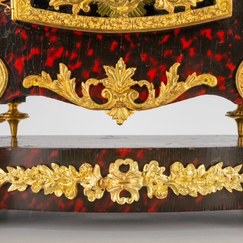 A table clock on console, made of tortoise shell and mounted with ormolu bronze.…