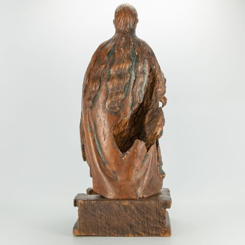 An antique wood sculptured statue of a holy figurine with lamb. Remains of origi…