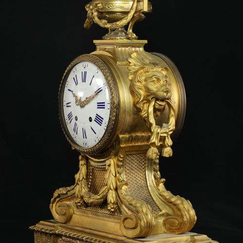 Louis XVI style gilded and chiseled bronze mantel set composed of a clock flanke…
