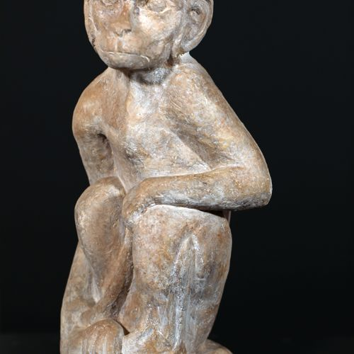 Sculpture in terracotta with white/grey patina representing a sitting monkey res…