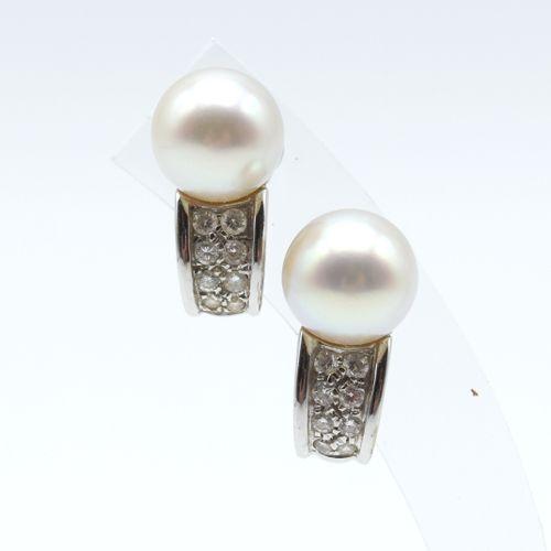 2 boucles d'oreilles en or blanc 18 ct signées BVLGARI serties de 16 brillants +…