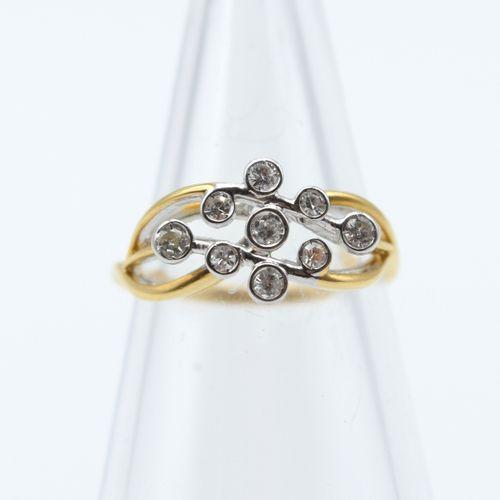 Bague en or jaune et blanc 18 ct sertie de 5 brillants +/ 0.15 ct et 4 diamants …