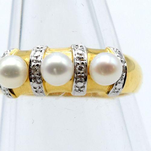 Bague en or jaune et blanc 18 ct sertie de 4 diamants taille 8/8 +/ 0.04 ct et 3…
