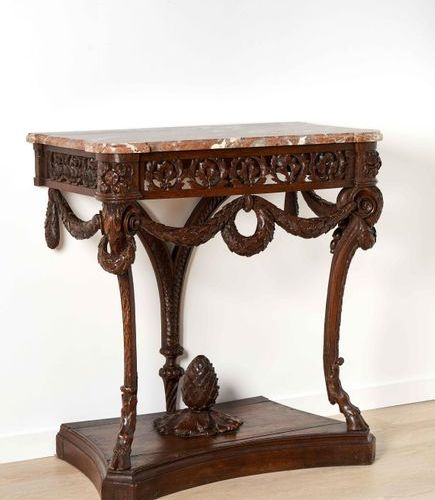 ÉLÉGANTE CONSOLE French work from the Louis XVI period In carved oak, resting on…