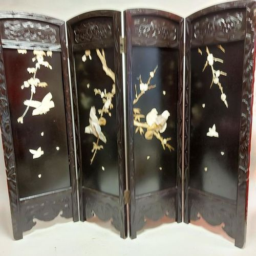 ASIA. Folding screen with 4 leaves in carved blackened wood decorated with bone …