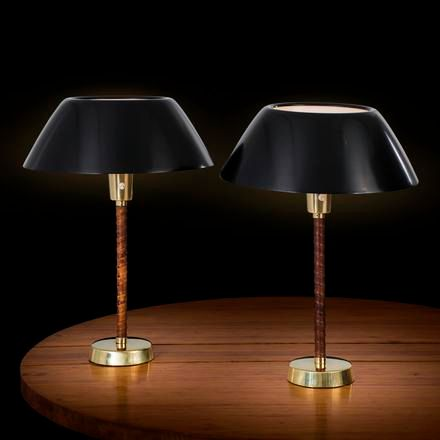 "LISA JOHANSSON PAPE A pair of ""Senator"" table lamps with black shades and leathe…"