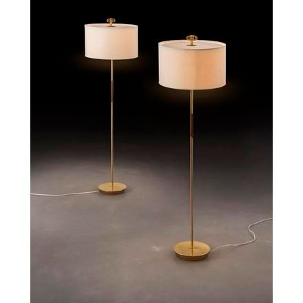 PAAVO TYNELL A pair of floor lamps with flat feet and leather details, similar t…