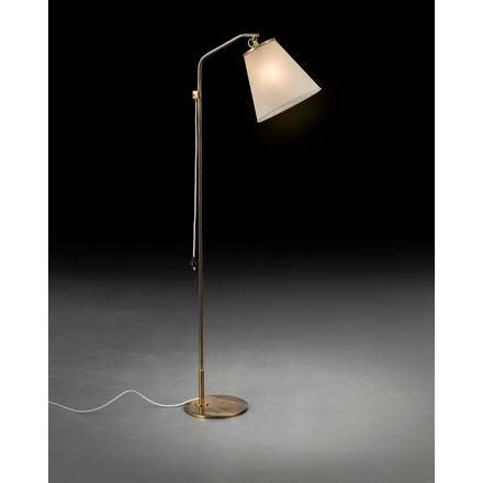 PAAVO TYNELL A floor lamp with rattan around the stem and a fabric shade, design…