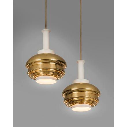 """Alvar Aalto A pair of brass """"A335"""" pendant lamps with long stems designed by Alv…"""