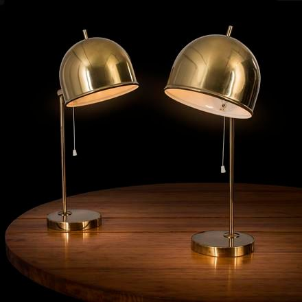 """Eje Ahlgren A pair of brass orientable """"B 075"""" table lamps, designed by Eje Ahlg…"""