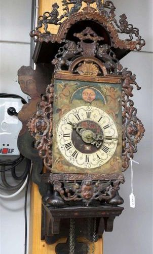 A Groningen chair clock, 2nd half of the 18th century. Polychrome decorated wood…