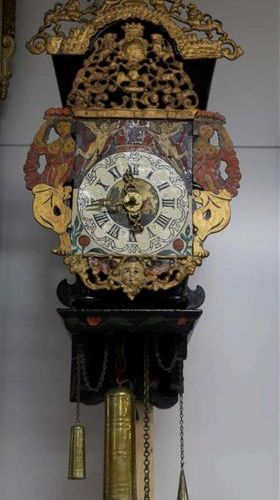 A chair clock, Friesland, 18th century. Polychrome decorated wooden chair with c…
