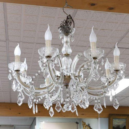 A six arm chandelier with pendants, 20th century.